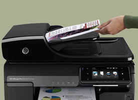Hand inserting document into ADF on an HP Officejet Pro 8500A Premium