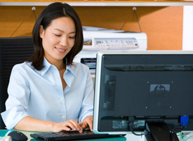 Woman using desktop computer