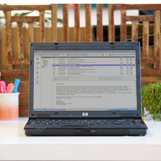 A laptop sitting on an outdoor table.