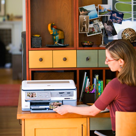 A woman using her home office printer.