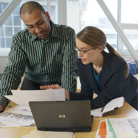 Man and woman reviewing business documents