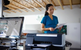 Lady in office using HP Officejet Pro printer