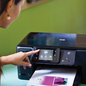 Woman using printer touchscreen