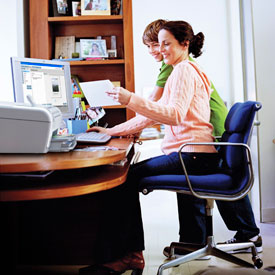 woman and child working at her desk