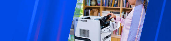 Woman inserting toner into LaserJet with blue color wash