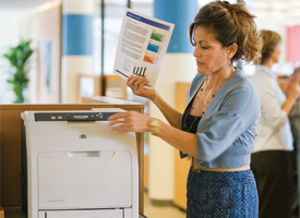 Woman with color document using HP LaserJet
