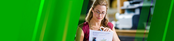 Woman looking at document with green color wash