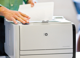 Man using HP LaserJet CP2055