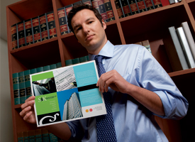 Man holding a color brochure