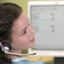 woman with headset giving 24/7 toll free phone support