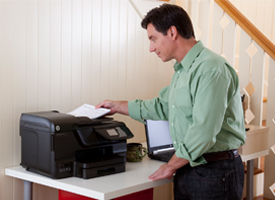 man putting documents in printer ADF