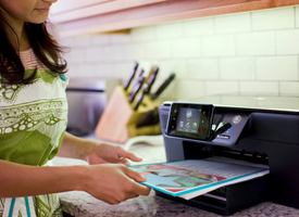 Woman printing wirelessly in kitchen